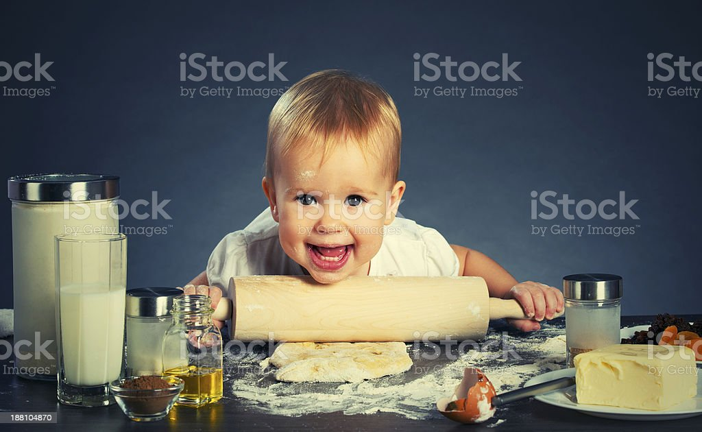Little baby girl is cooking, baking royalty-free stock photo