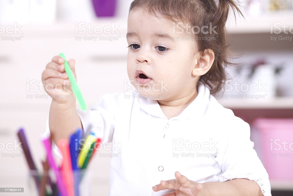 Little baby girl playing royalty-free stock photo