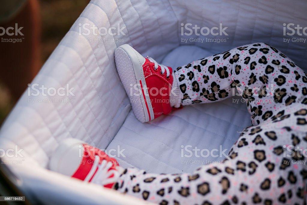 Little baby girl sleeping in  carriage stock photo
