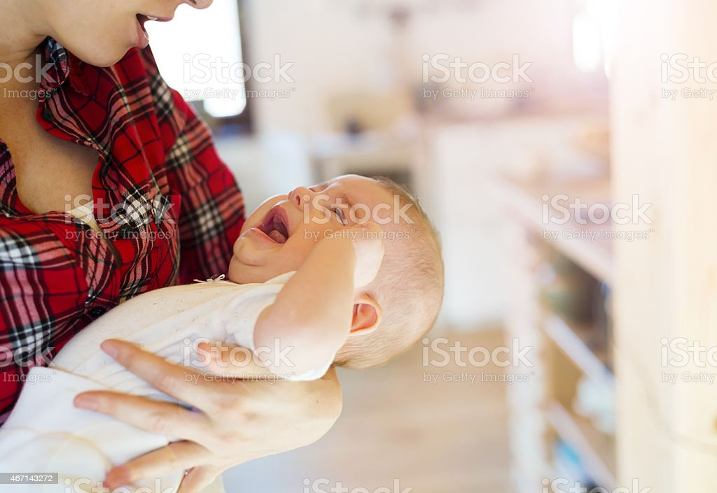 Little baby girl with her mother stock photo