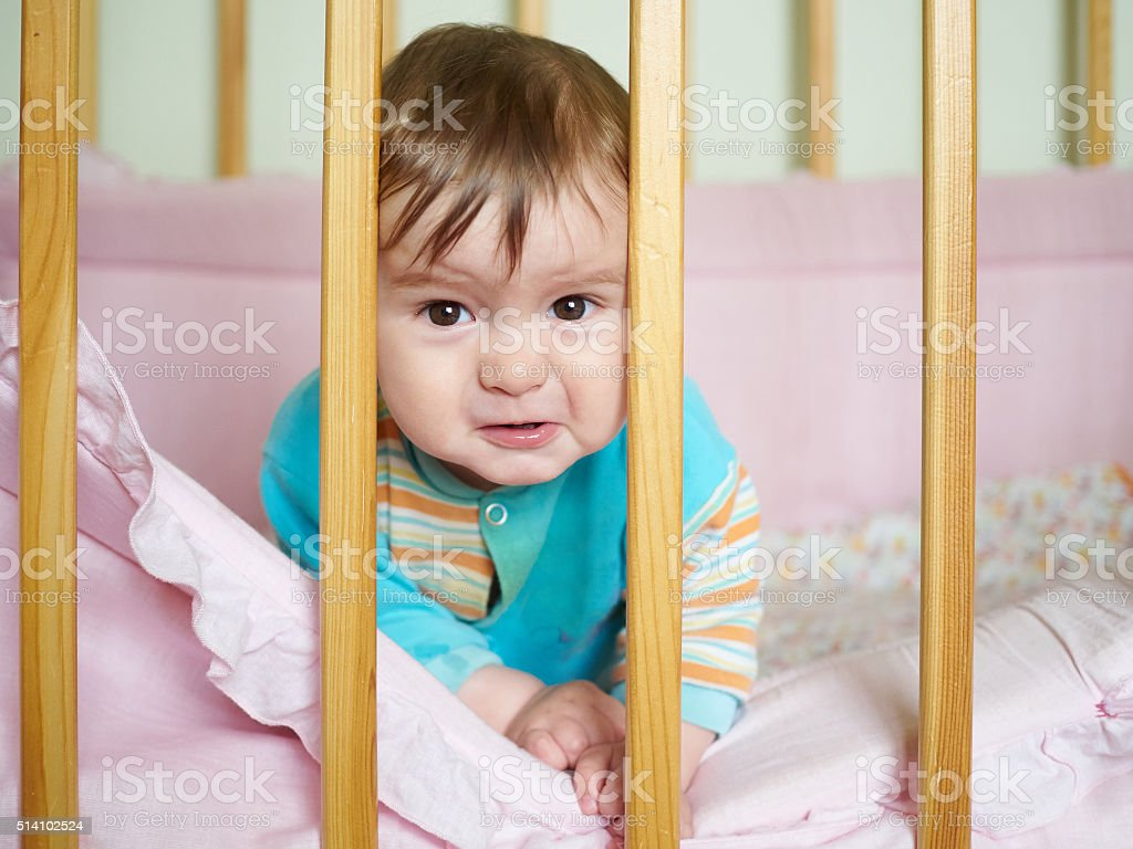 Little baby in a cot. stock photo