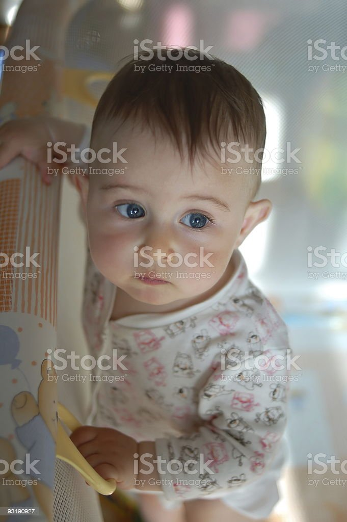 Little baby in playpen stock photo