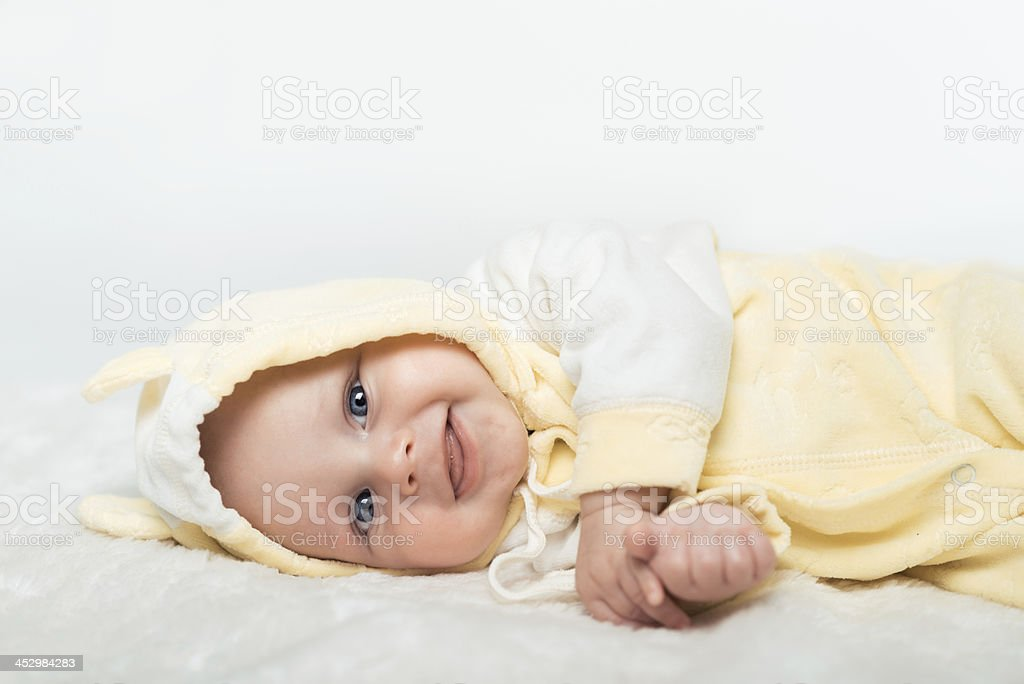 Little baby is smilling in the yellow shirt royalty-free stock photo