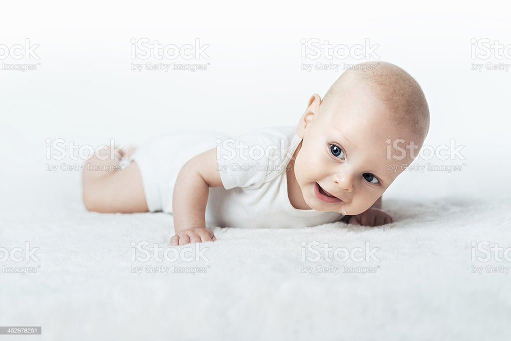 Little baby is smilling on the carpet royalty-free stock photo