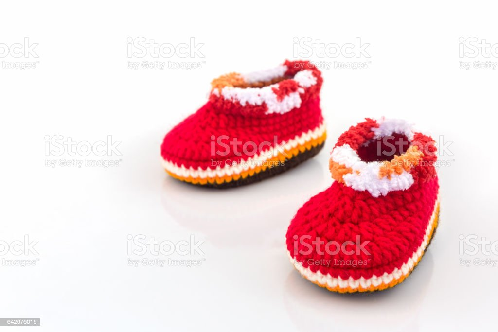 Little baby shoes. Kids knitted shoe handicraft. stock photo
