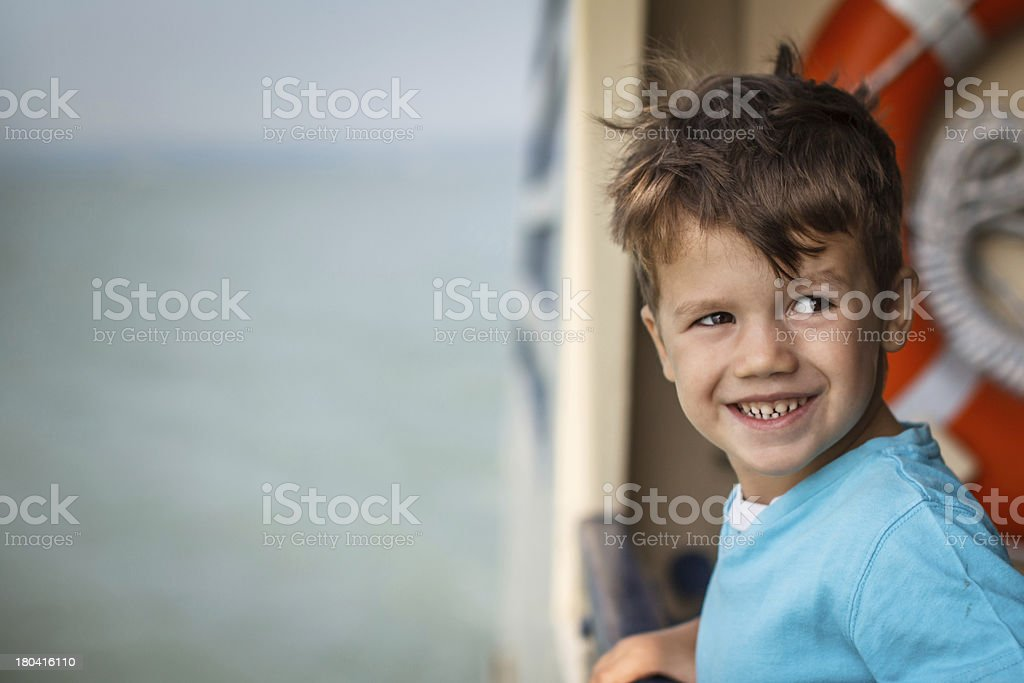 Little bad boy on deck ship royalty-free stock photo