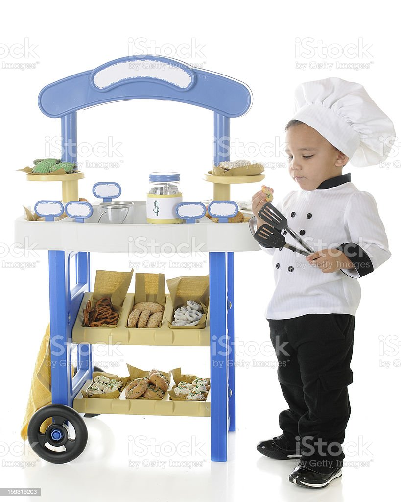 Little Baker Snitching Cookies stock photo