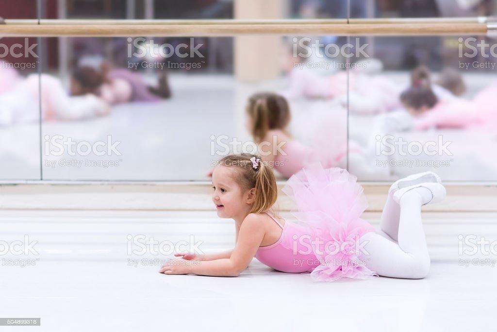 Little ballerina at ballet class stock photo