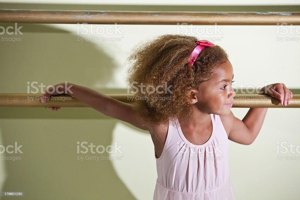 Little ballerina in dance studio stock photo
