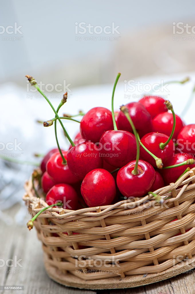 Little basket of cherries. stock photo
