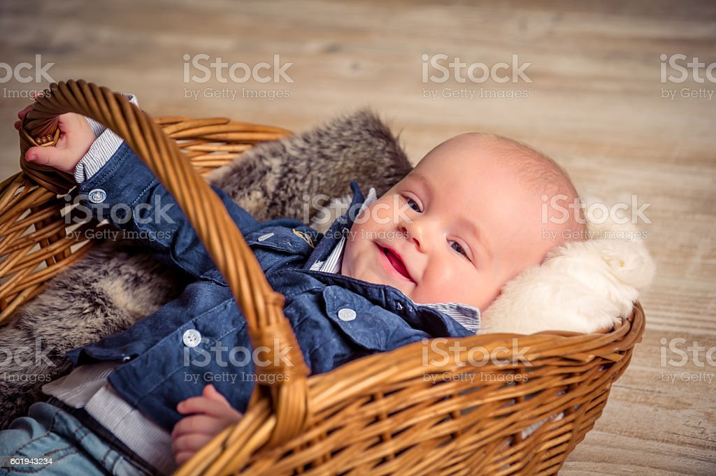 little beautiful child in the basket stock photo
