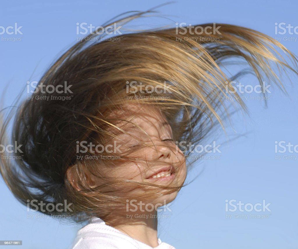 Little beautiful girl with blown hair royalty-free stock photo