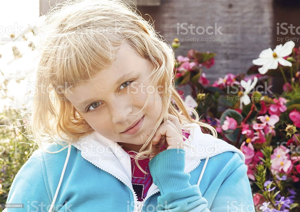 Little beauty blond girl smiles. Bright colorful portrait outdoo royalty-free stock photo