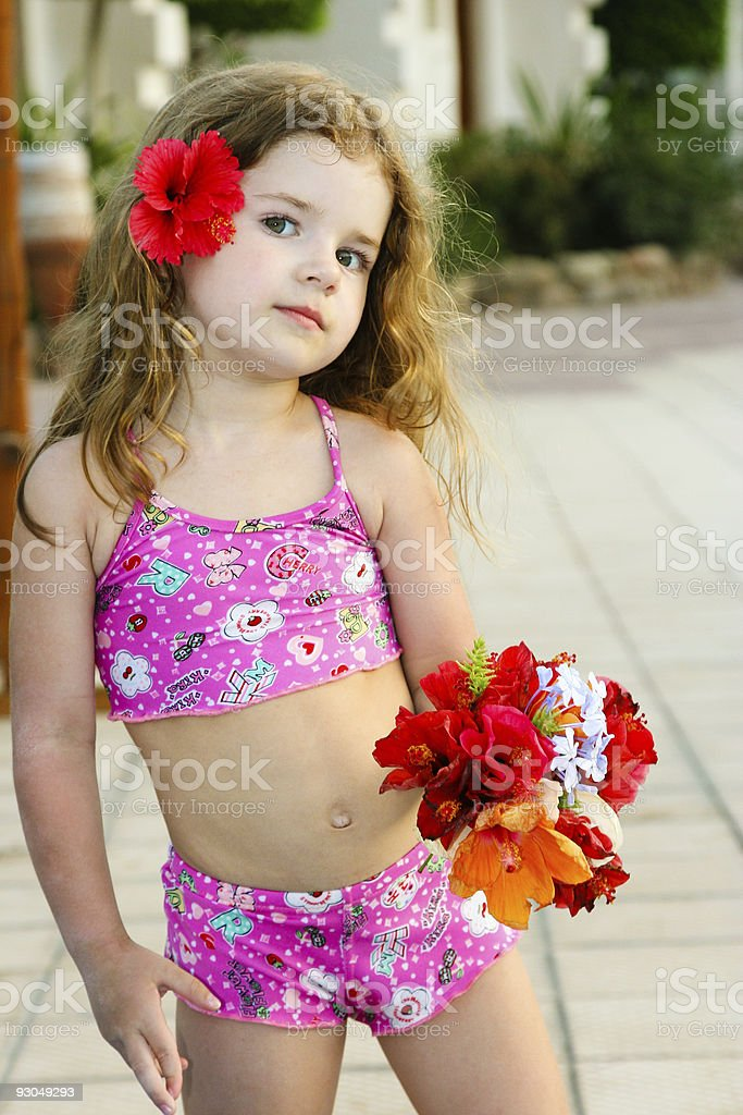 Little beauty with flowers royalty-free stock photo