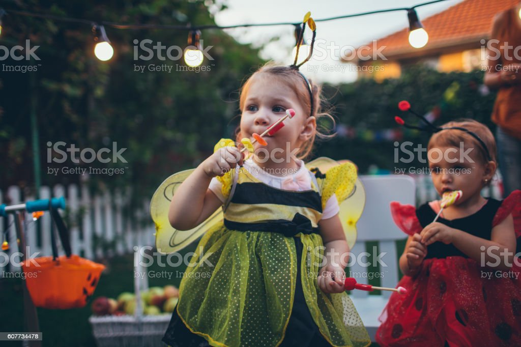 Little bee and lady bug having some Halloween candy stock photo