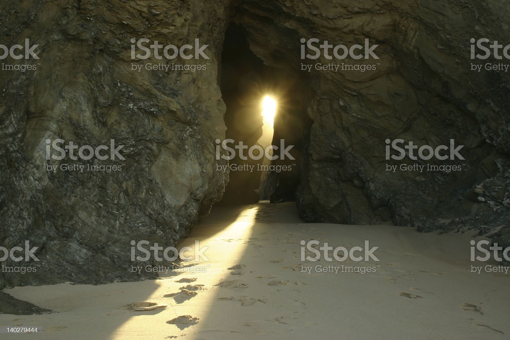 A little bit of sunlight shining through the rocks  royalty-free stock photo