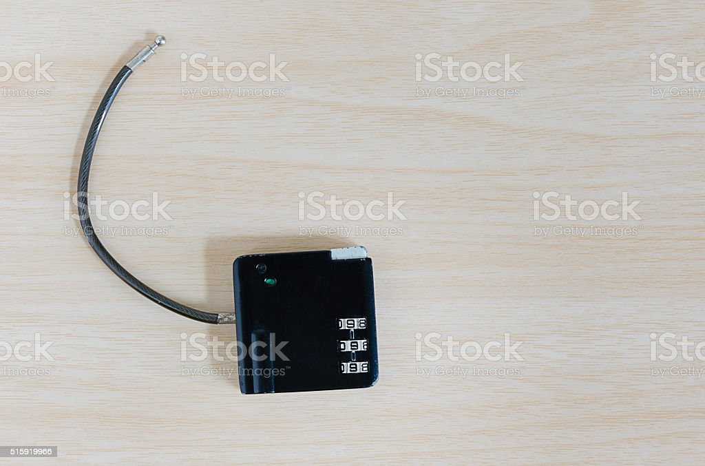 little black combination padlock on wooden background stock photo