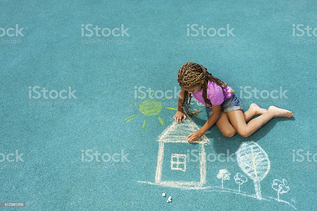 Little black girl drawing chalk house image stock photo
