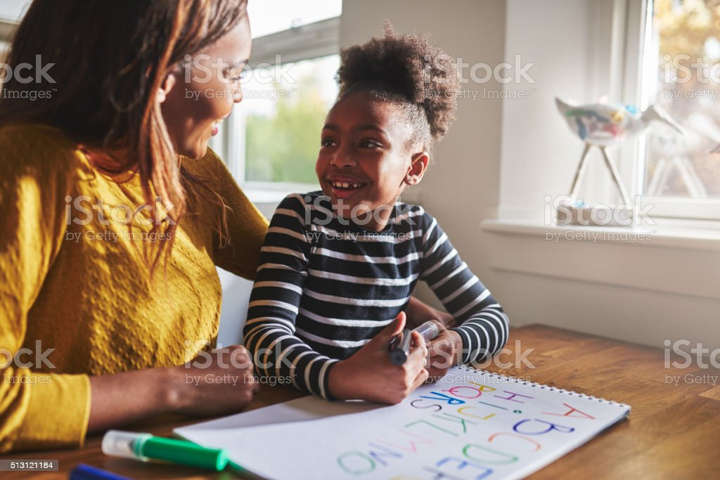Little black girl learning to calculate stock photo