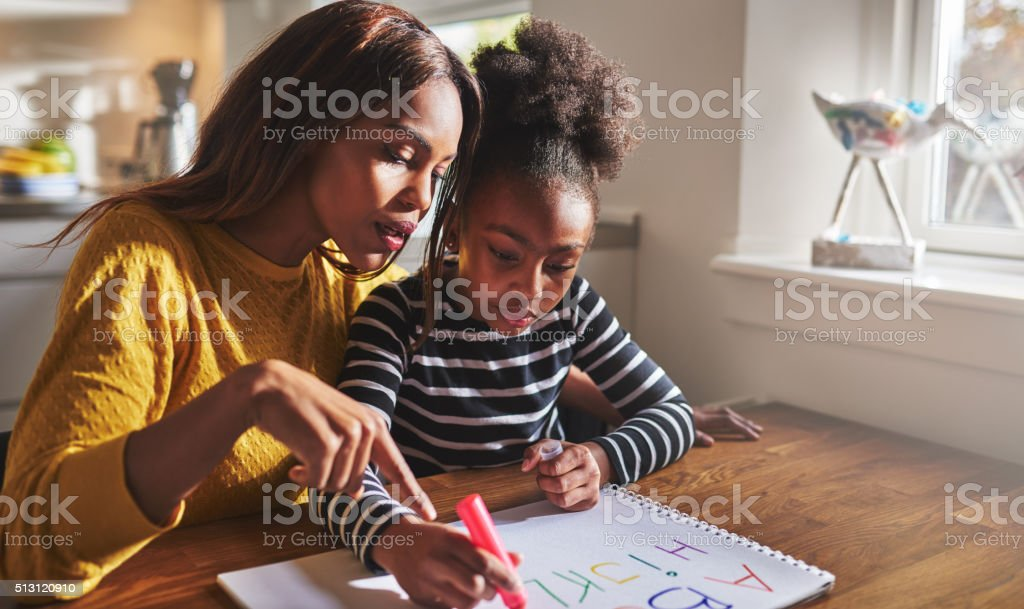 Little black girl learning to read stock photo