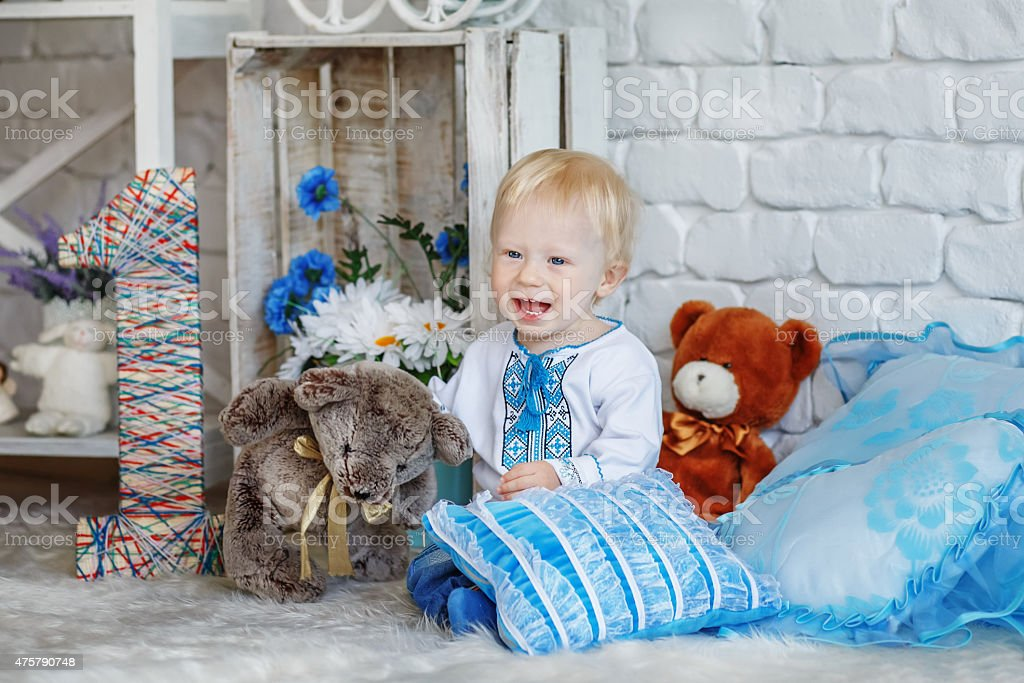Little blond boy in traditional Ukrainian embroidered shirt stock photo
