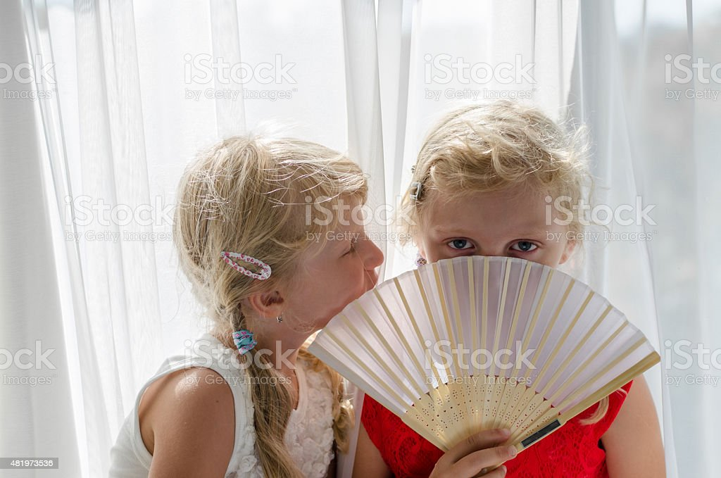 little blond girls in red and white dress with fan stock photo
