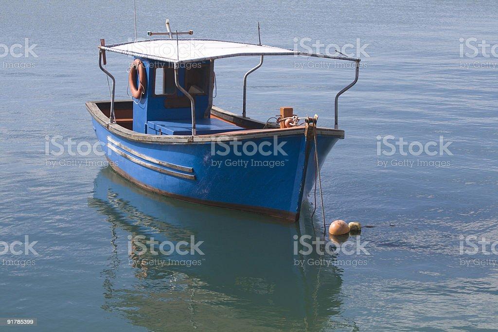 Little blue fishing boat stock photo
