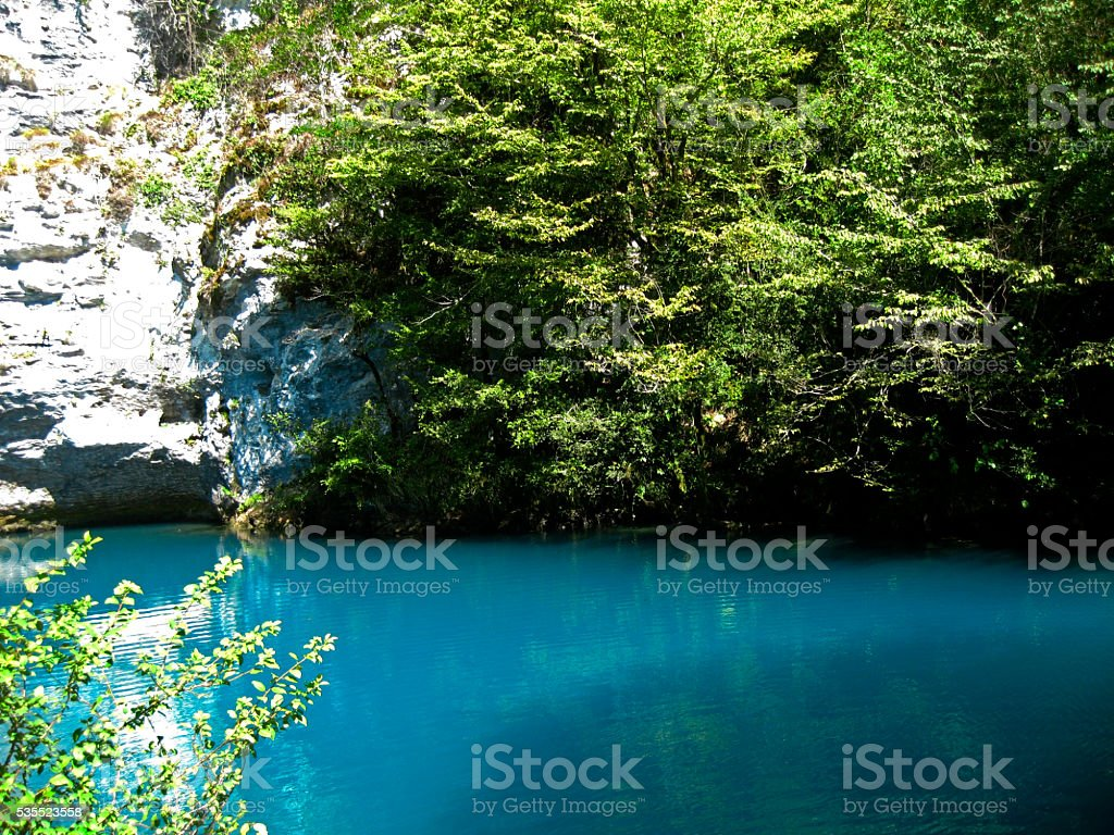 Little blue lake in the middle of the caucasus mountains stock photo