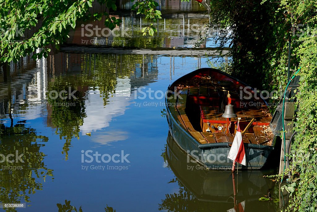 little boat on a blue colored river stock photo