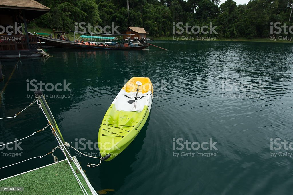 Little boat on green water stock photo