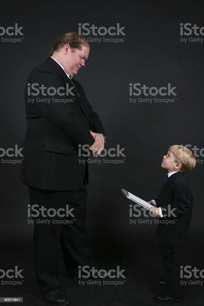 Little Boss - Junior Executive Small Boy and Big Man royalty-free stock photo