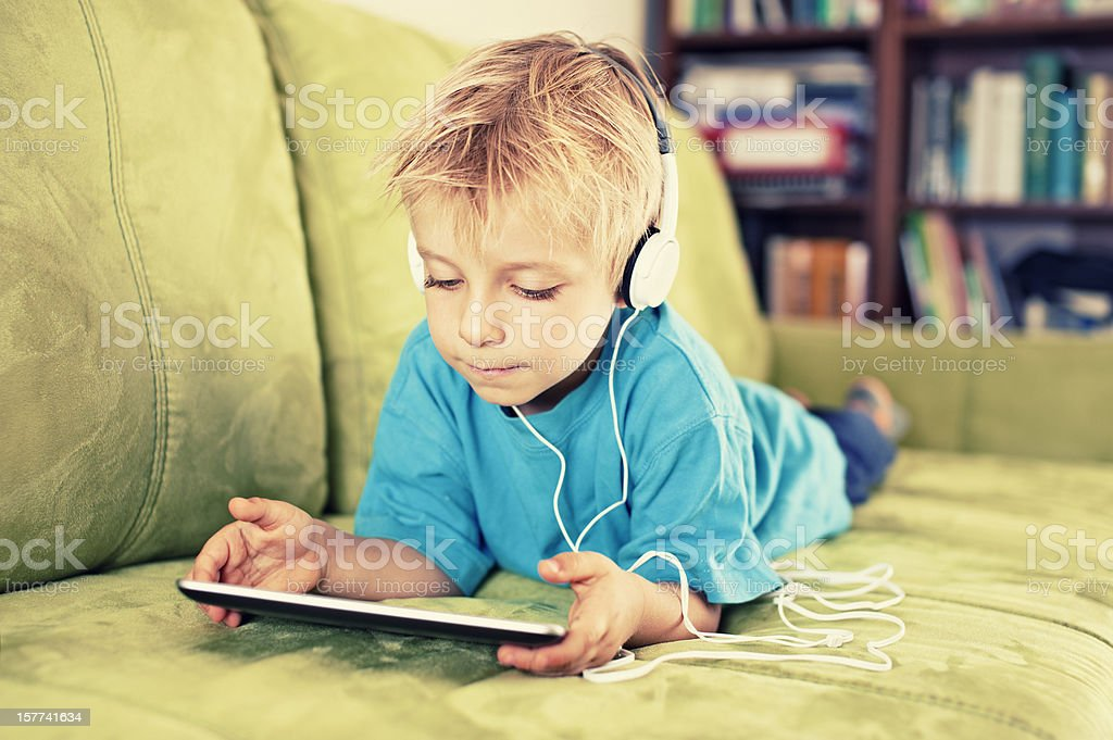 Little boy and a tablet royalty-free stock photo