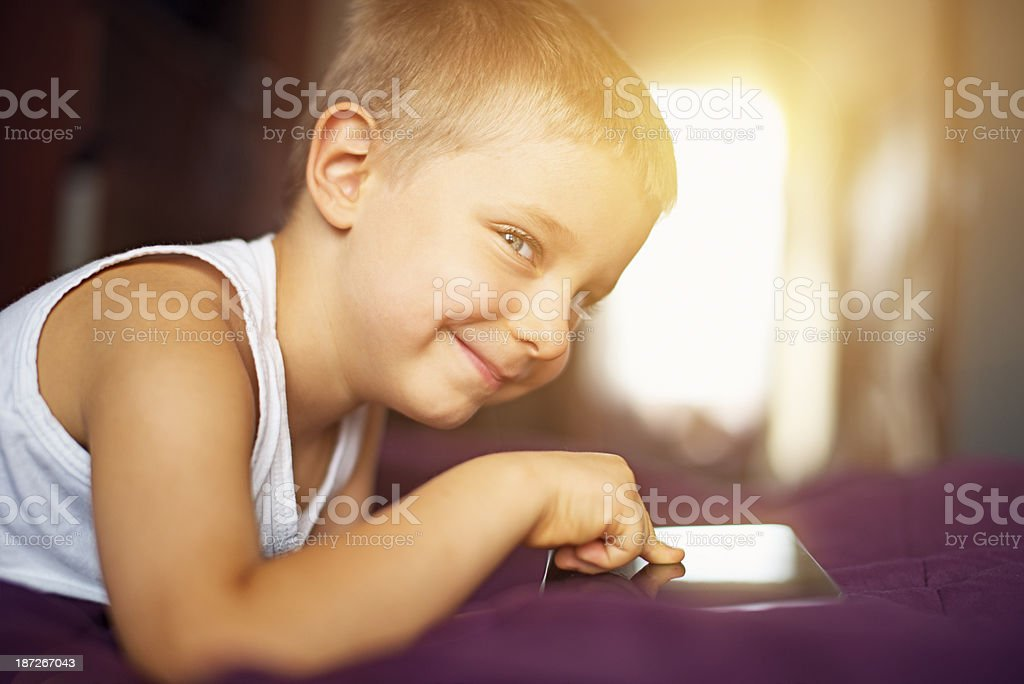 Little boy and a tablet stock photo