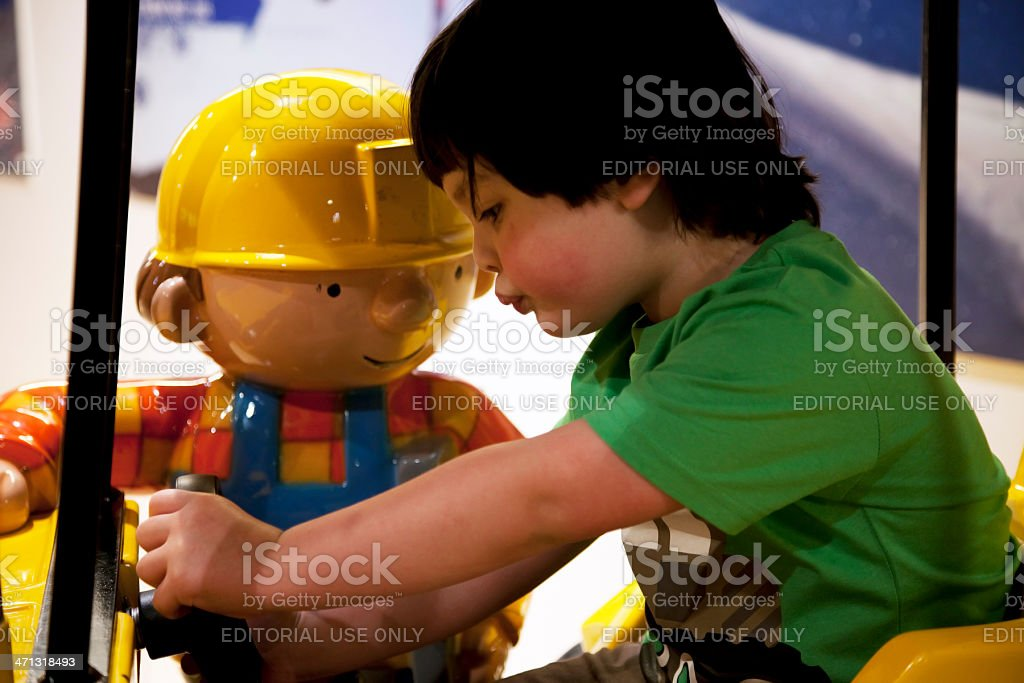 Little boy and Bob the Builder stock photo