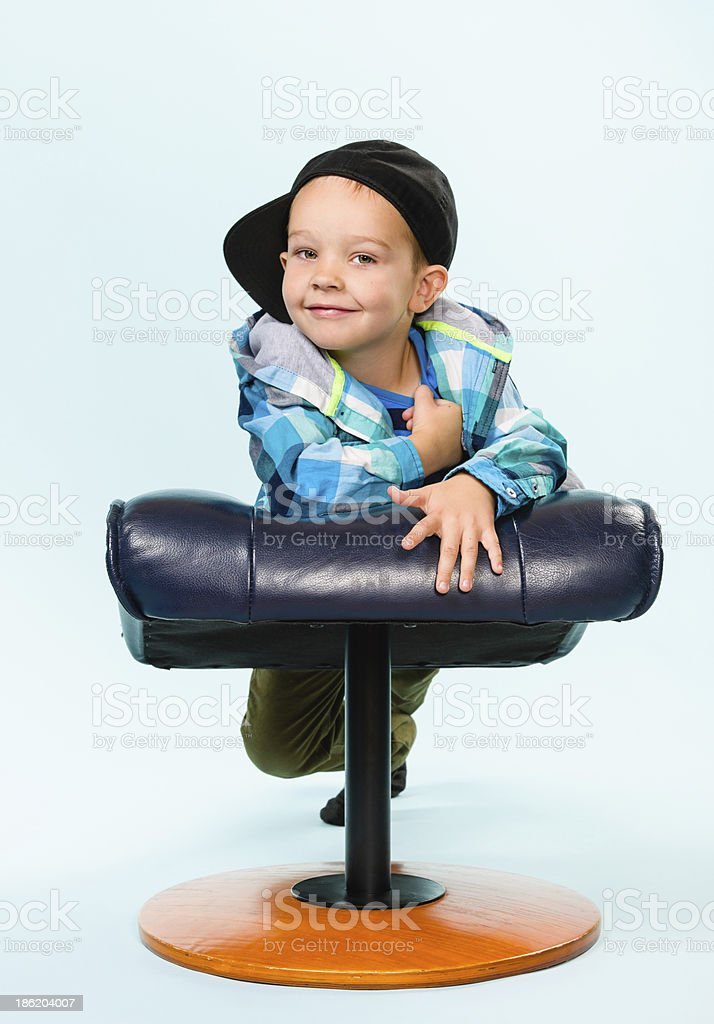 Little boy and footstool stock photo