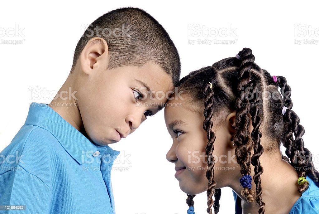 Little Boy and Girl Facing Each Other royalty-free stock photo