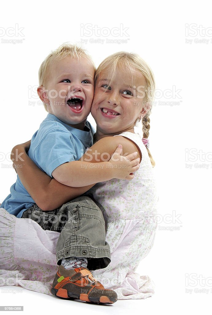 little boy and girl hugging and smiling royalty-free stock photo