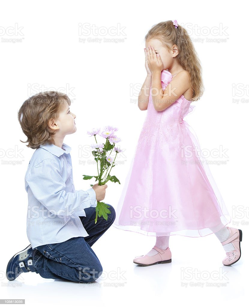Little boy and girl in love stock photo