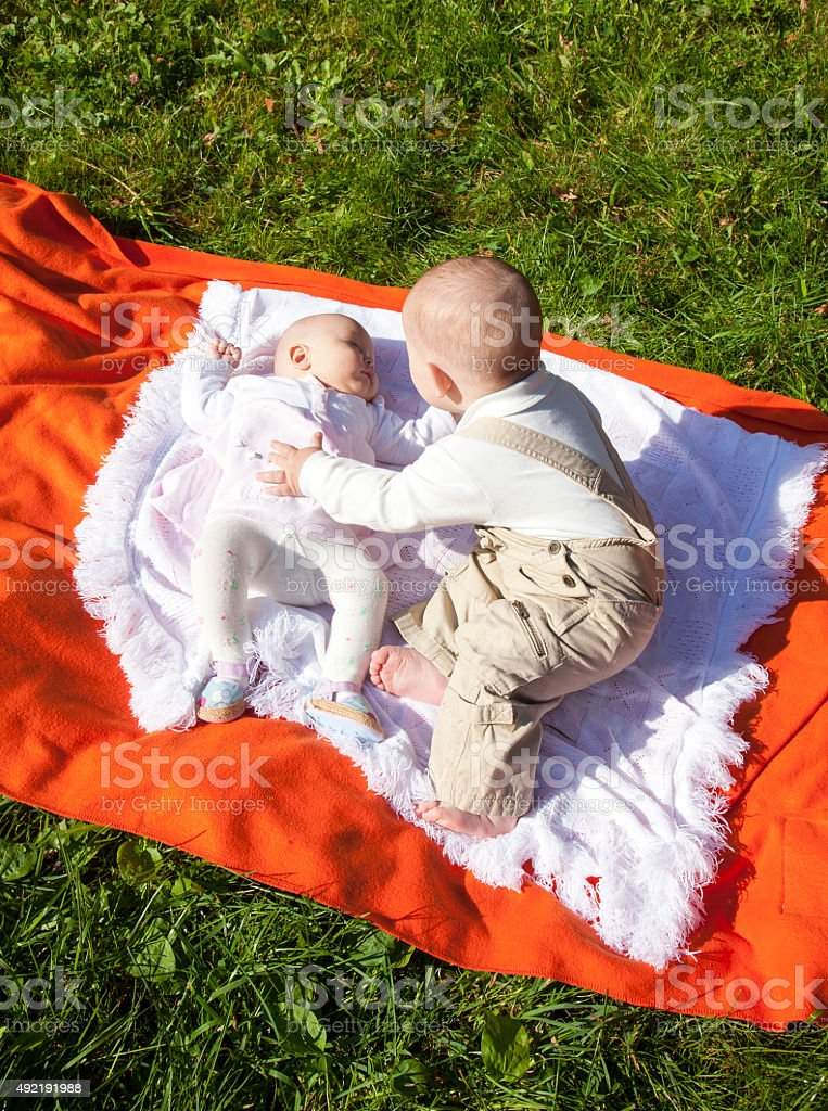 Little boy and girl on plaid. stock photo