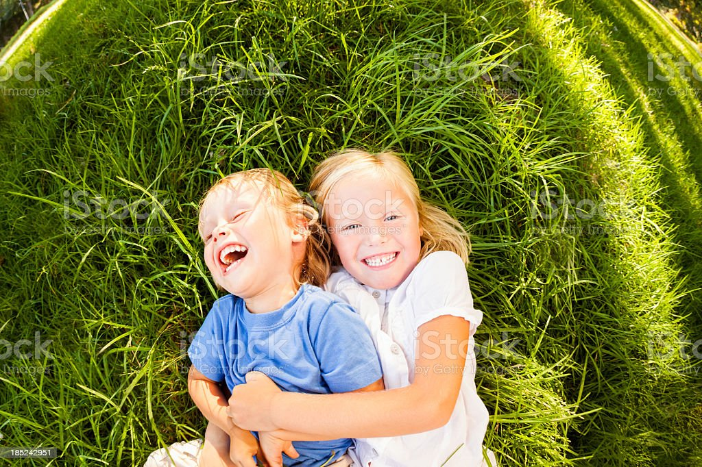 Little Boy And Girl Playing Together stock photo