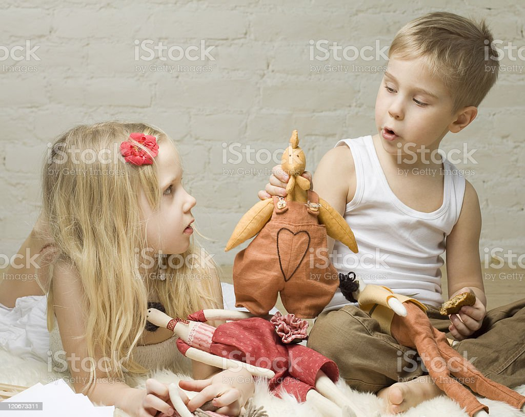 Little boy and girl playing with stuffed animals stock photo
