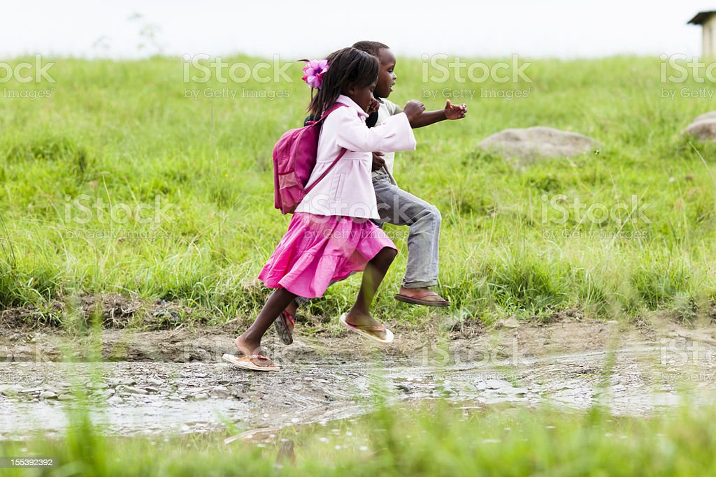 Little boy and girl running royalty-free stock photo