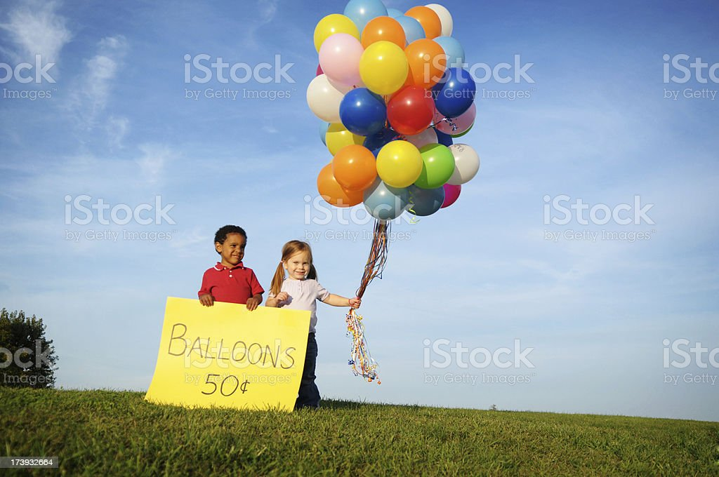 Little Boy and Girl Selling Balloons Outside royalty-free stock photo