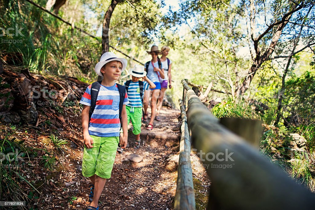 Little boy and his family hiking in Majorca mountains stock photo