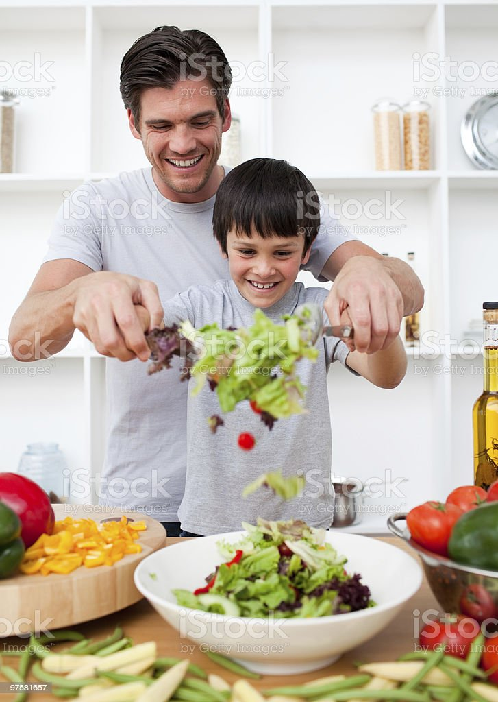Little boy and his father cooking stock photo