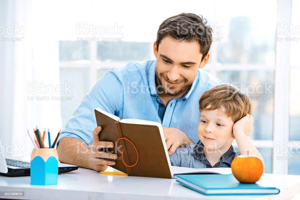 Little boy and his father stock photo