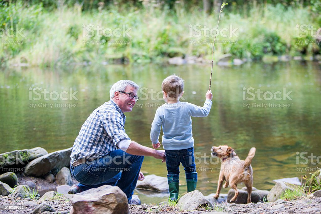 Little boy and his grandad stock photo