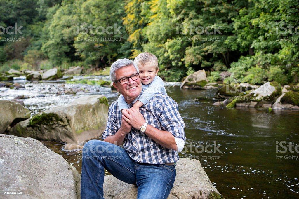 Little boy and his grandad stock photo