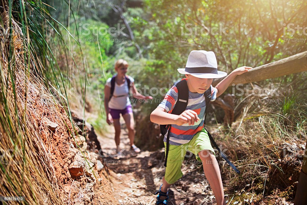 Little boy and his mother hiking in Majorca mountains stock photo