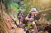 Little boy and his mother hiking in Majorca mountains